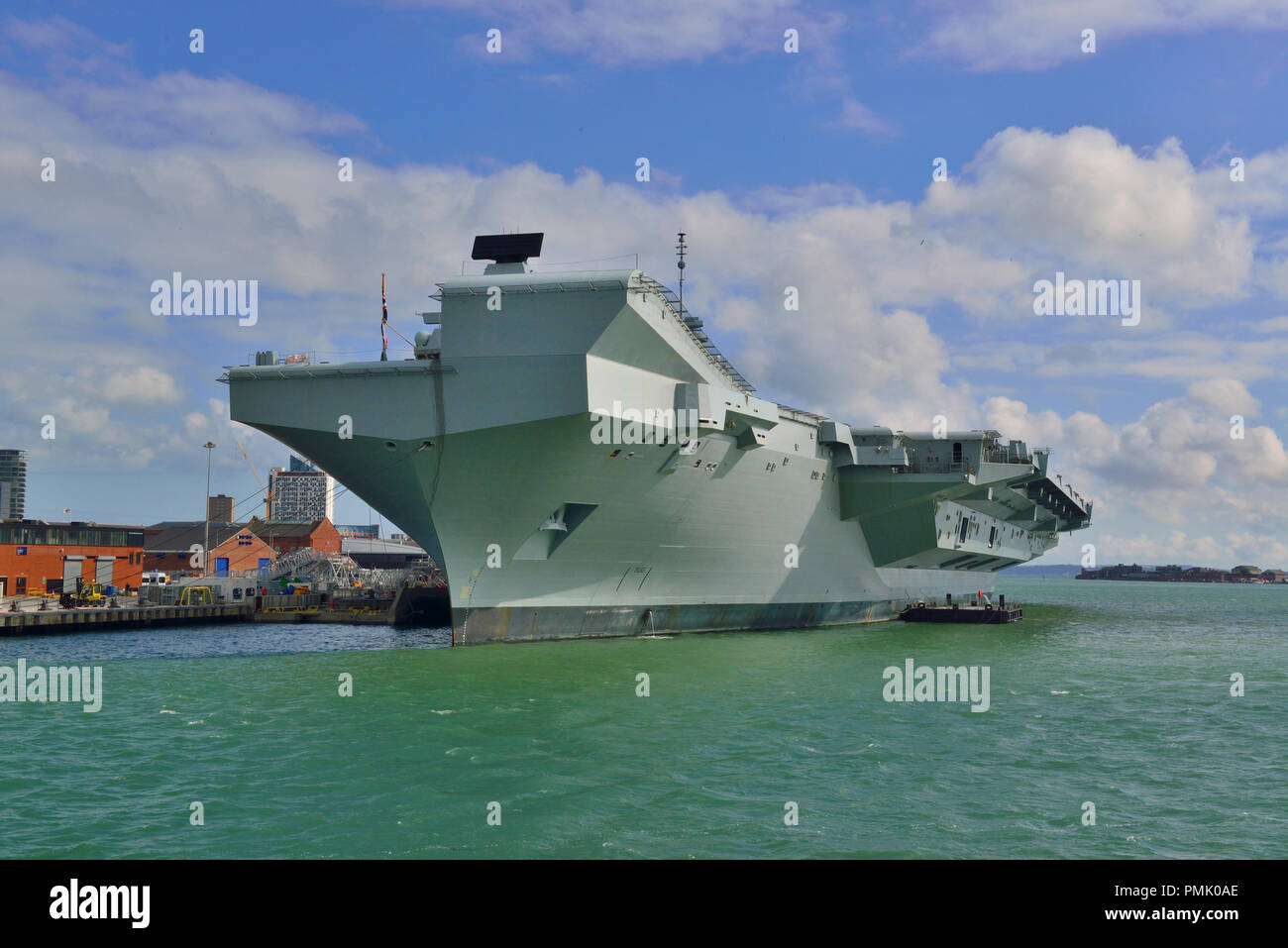 HMS Queen Elizabeth at Portsmouth. The  Queen Elizabeth-class aircraft carrier  will be the largest & most powerful warships in UK history - Stock Image