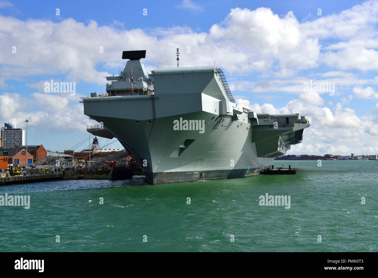 HMS Queen Elizabeth at Portsmouth . The  Queen Elizabeth-class aircraft carrier  will be the largest & most powerful warships in UK history - Stock Image