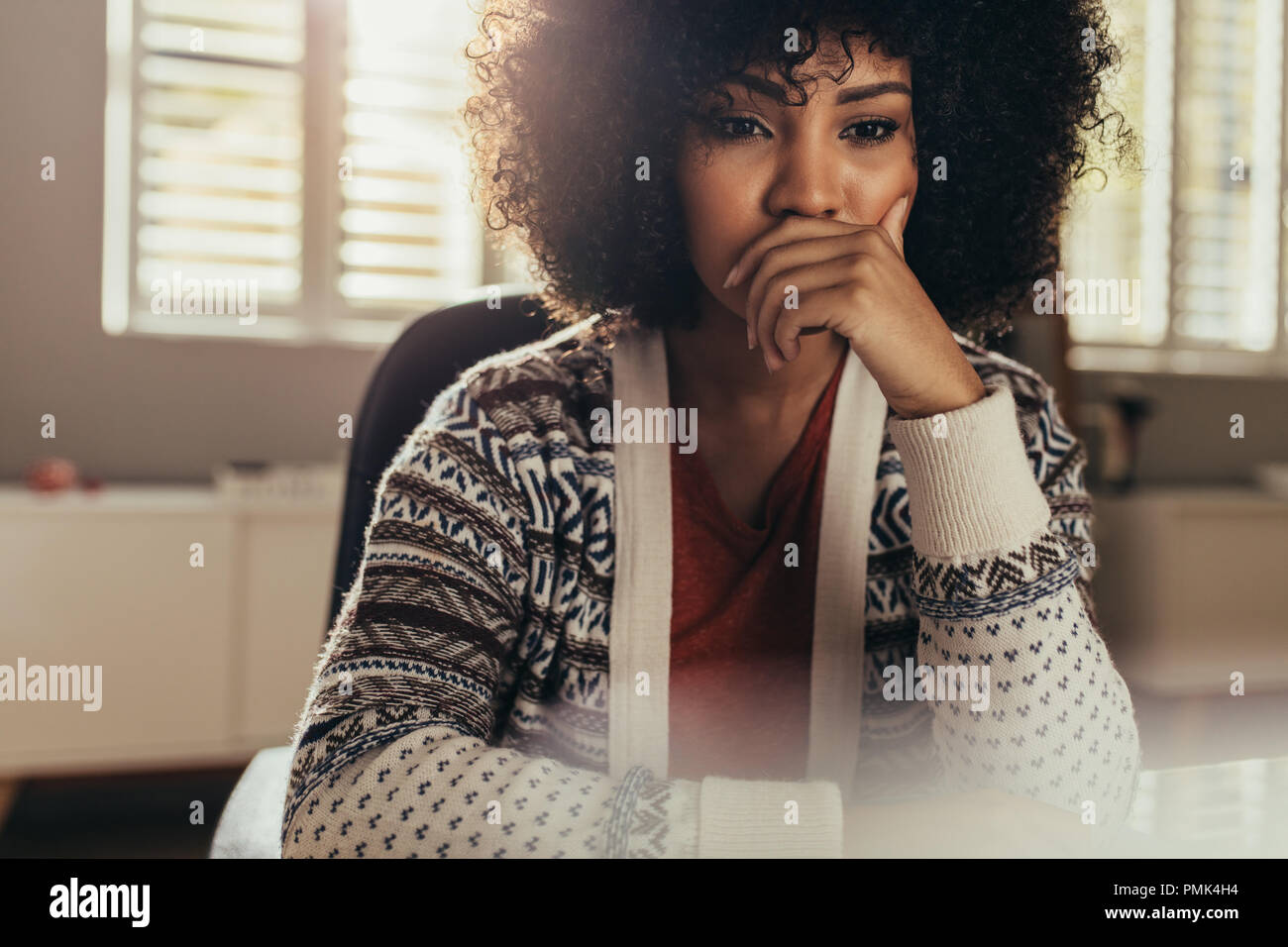 Young female architect thinking about new ideas. Woman designer sitting in office and working on new project. - Stock Image