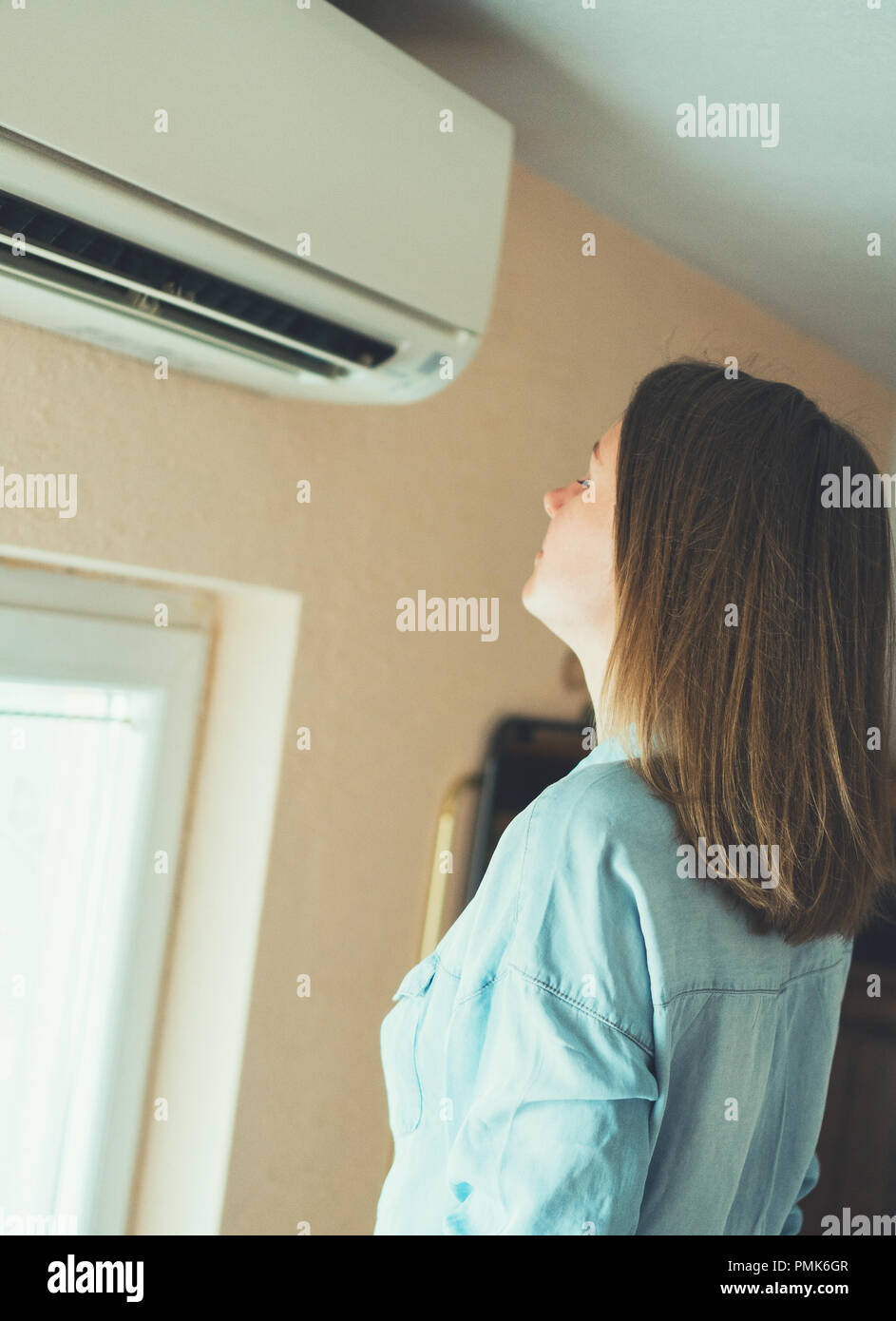 Women dying from the heat standing in front of the air conditioner ... 0e150b52dc