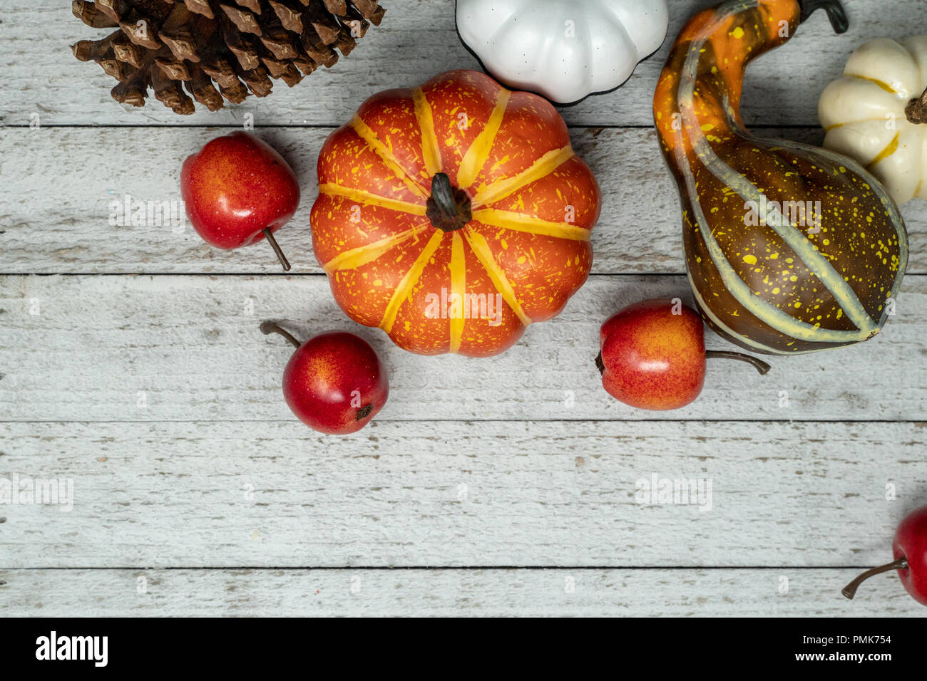 fall scene with various pumpkins and gourds apples squash wooden