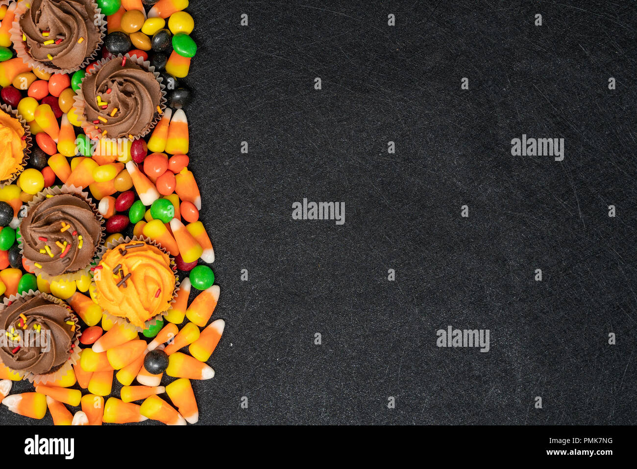 halloween themed candy and treats candy corn and cupcakes right