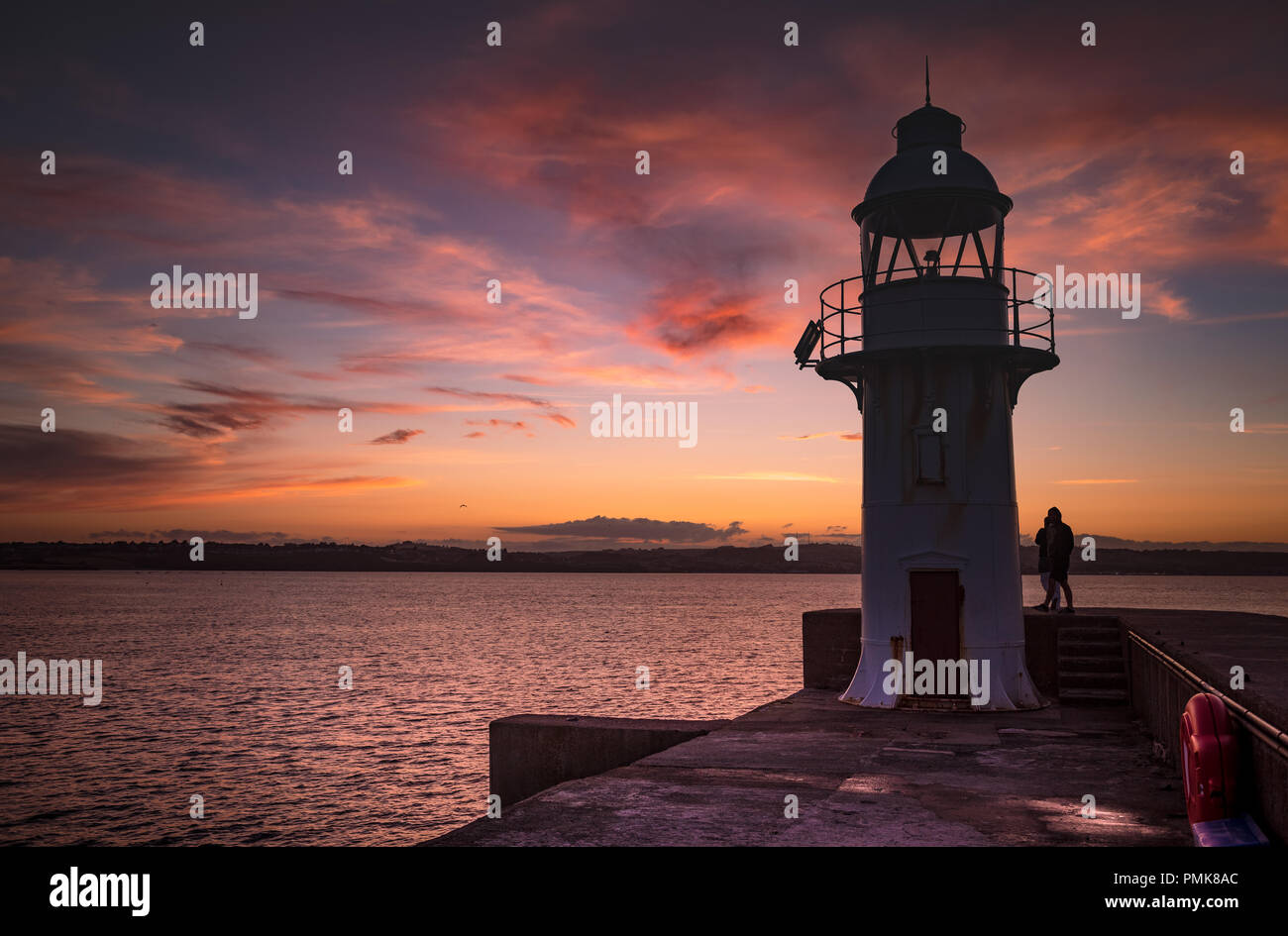 Brixham Lighthouse at dusk - Stock Image