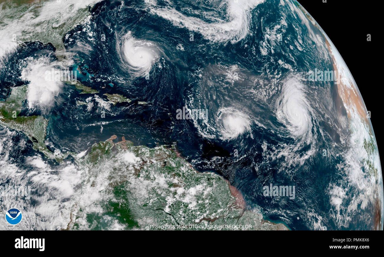 Category 4 Hurricane Florence, upper left, is seen  from the GOES-East satellite on Tuesday, September 11, 2018. Latest forecasts have the powerful storm heading into the Carolinas on the U.S. East Coast. Over 1 million people have been evacuated as this is the biggest storm to hit the Carolinas since 1954. (NOAA/Handout) Stock Photo