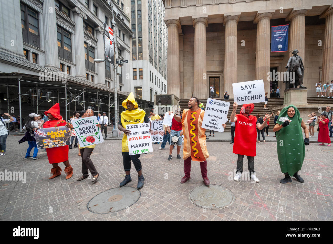Protesters from Krupa Global Investments dressed as iconic ketchup and mustard bottles protest on Wednesday, September 12, 2018 the management of the Kraft Heinz Company by Berkshire Hathaway and 3G Capital, fearful that the investors are abandoning the company. Krupa wants the company, which has seen its share price drop, to take a number of steps to ensure a fair return to investors even if Kraft Heinz has to be taken private. KGI owns approximately $100 million of Kraft Heinz stock. (© Richard B. Levine) - Stock Image
