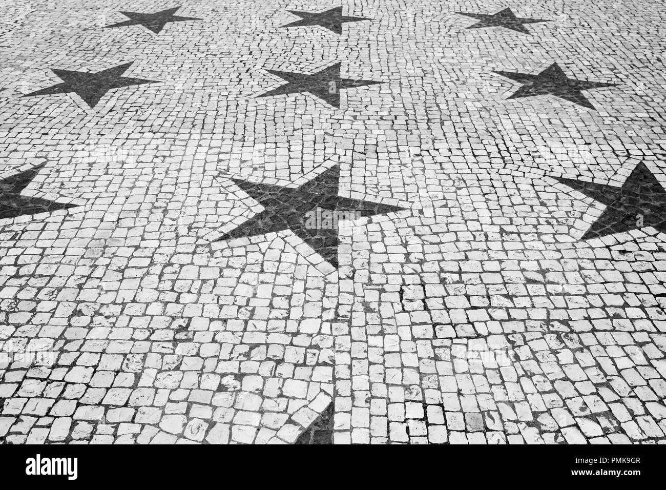 Mosaic street art with stars in black and white in the city of Ponta Delgada, Sao Miguel island, Azores - Stock Image