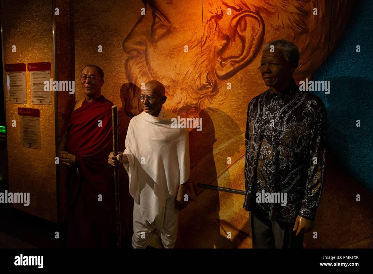 Mahatma Gandhi, Dalai Lama and Nelson Mandela in wax at the Madame Tussauds Wax Museum. Asmterdam, Netherlands - Stock Image