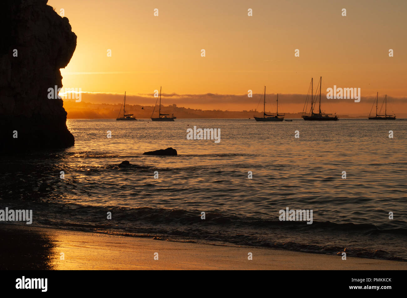 Anchored Sailboats at Daybreak - Stock Image