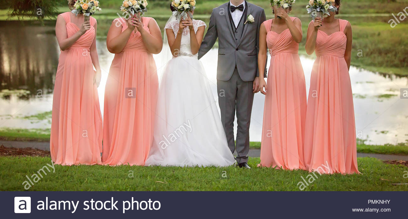 Bride Bridesmaids And Groom In Fun Pose With Bouquets After The