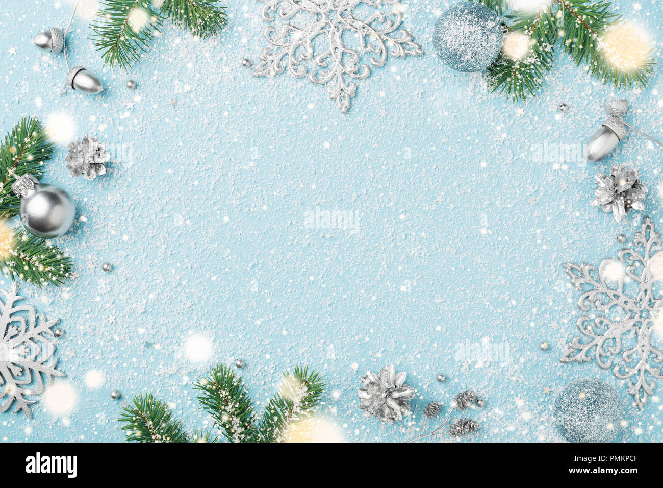 Light blue christmas frame of fir and silver new years ornaments