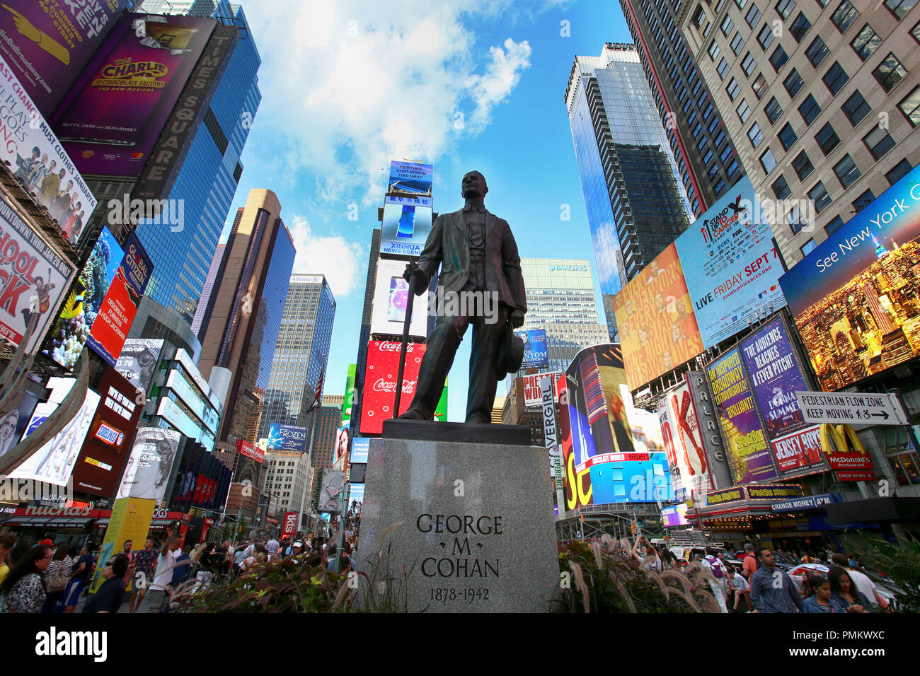 New York, USA – August 24, 2018: Statue of songwriter and performer George Cohan and many people on Times Square at 7th Avenue and Broadway in Midtown Stock Photo