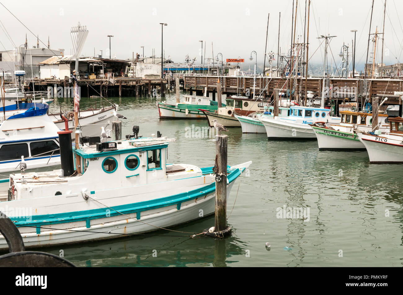 SAN FRANCISCO, CALIFORNIA, July 30th 2018. Small wooden fishing boats tied up near pier 39 in San Francisco. Stock Photo