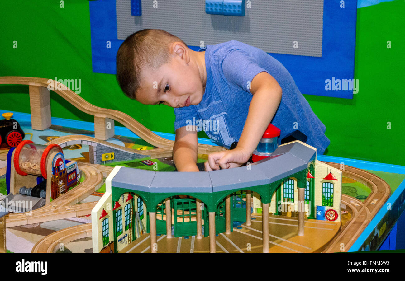 Young boy playing with a train table Stock Photo: 219263551