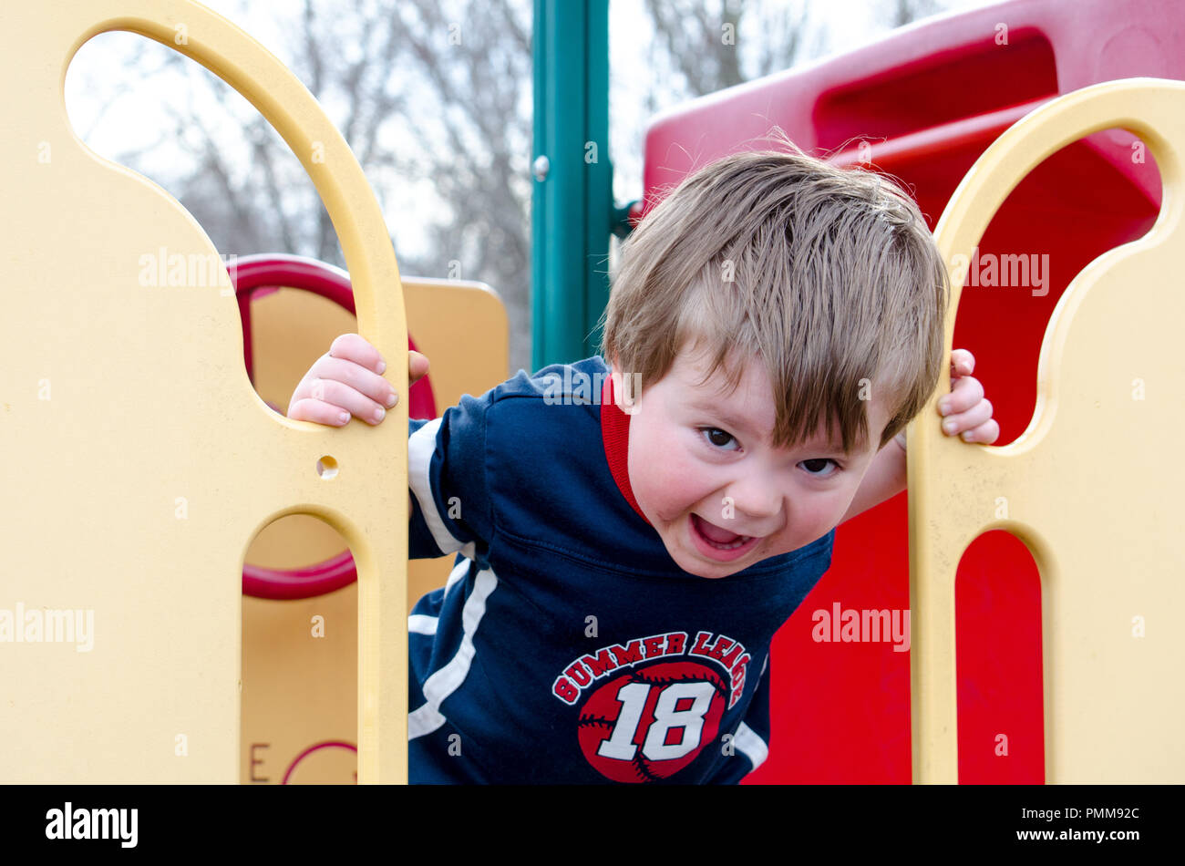 Yelling child at the park - Stock Image