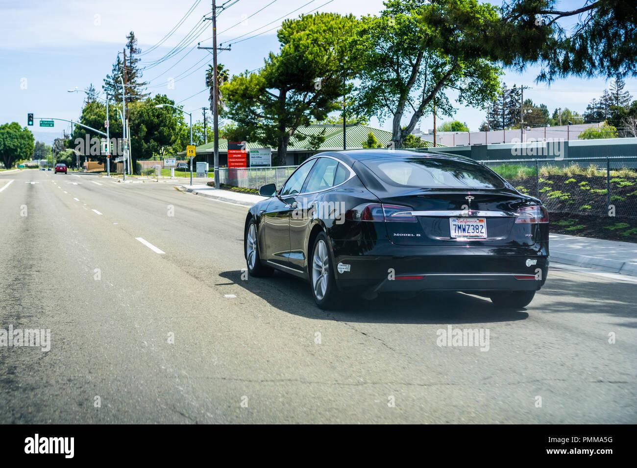 April 22, 2018 Santa Clara / CA / USA - Black Tesla Model S driving on a street in Silicon Valley Stock Photo