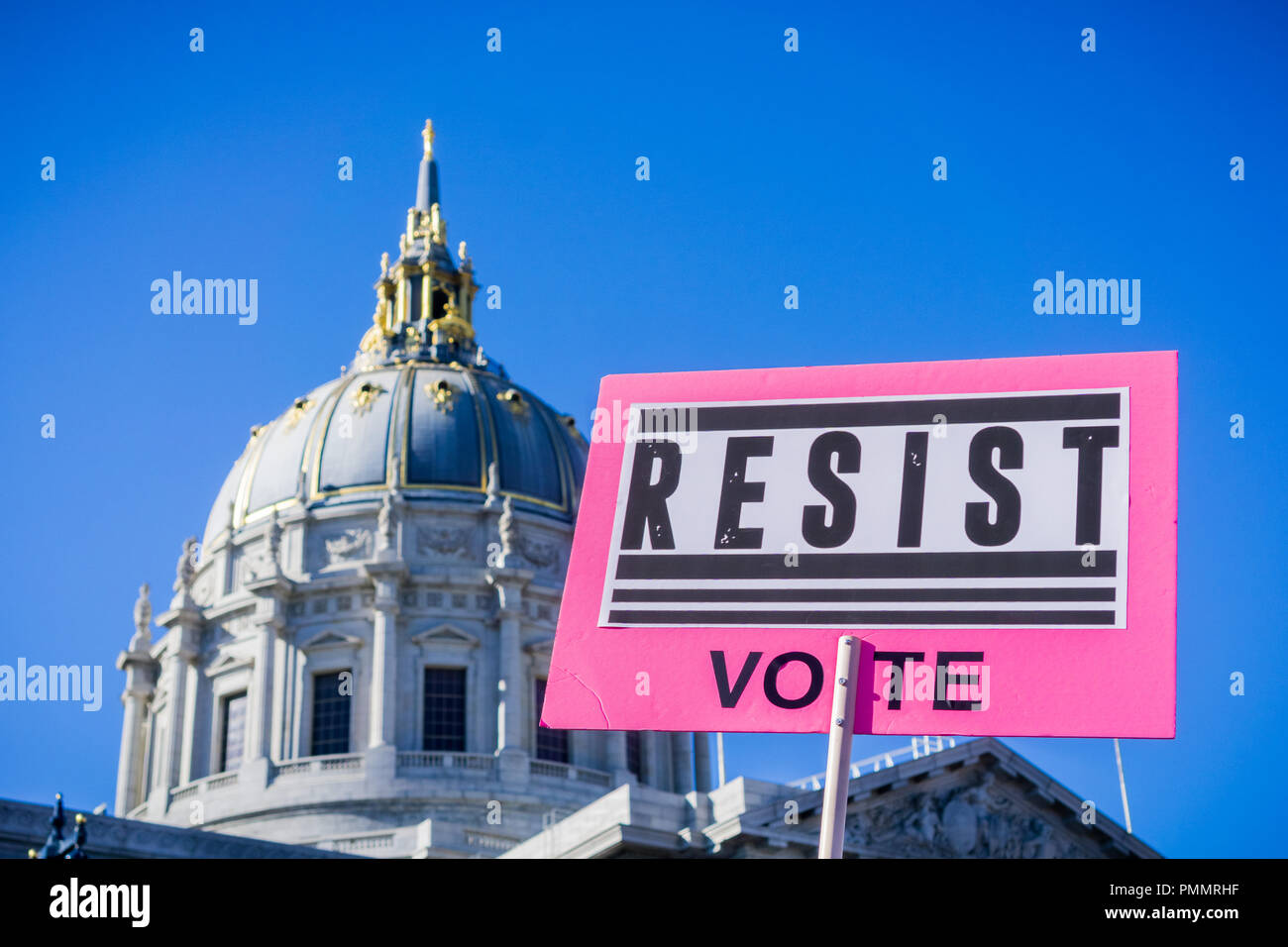 'Resist Vote' sign raised at the Women's March rally, Civic Center Plaza, San Francisco, California; the City Hall building in the background; - Stock Image