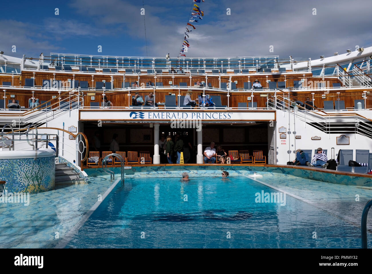 Two swimmers in a pool on a Cruise Ship at the start of a cruise - Stock Image