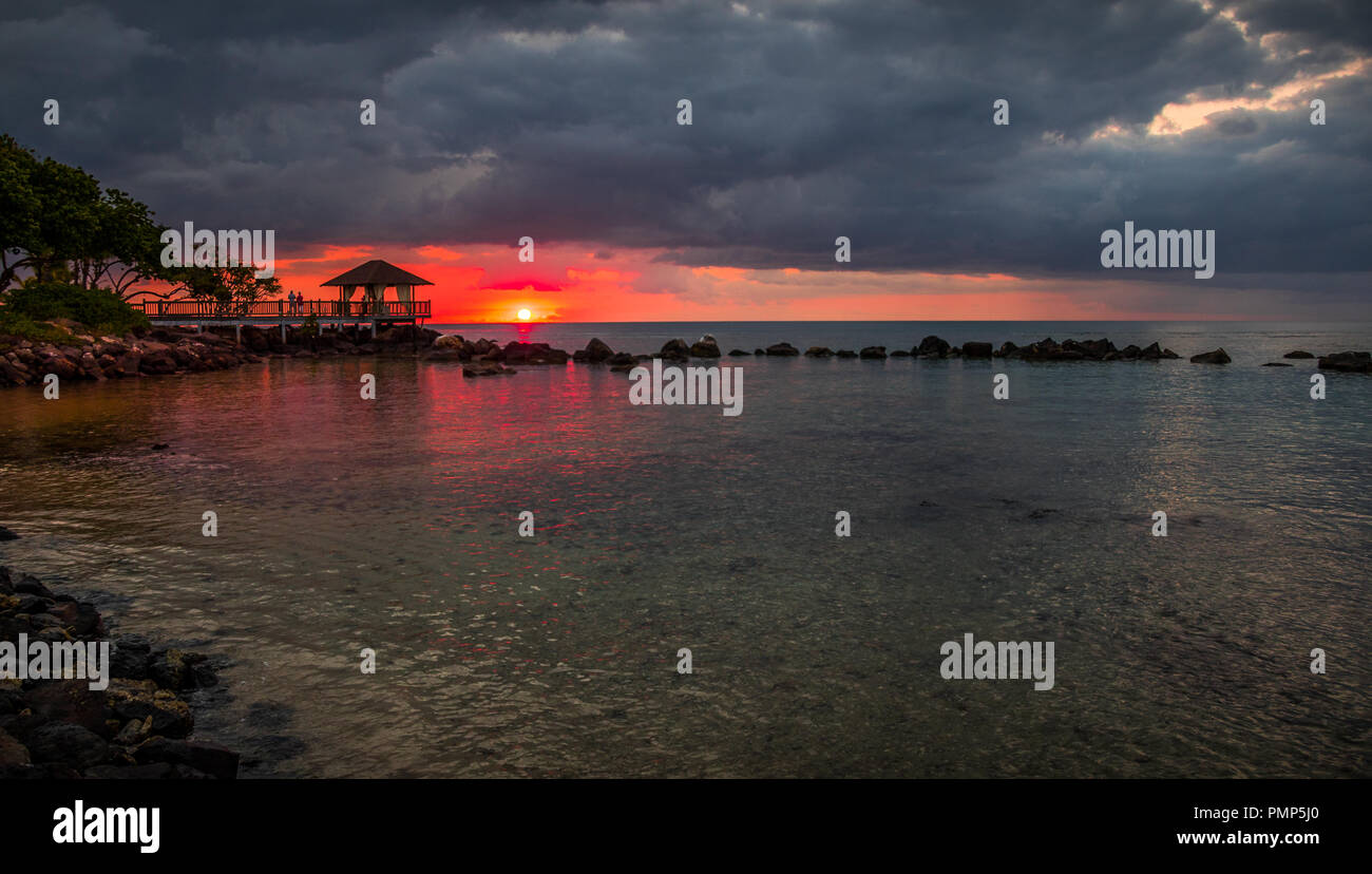 Balaclava, Mauritius - the sun sets over the bay at the Turtle Bay Resort and Spa on the coast of the Indian Ocean island image with copy space - Stock Image