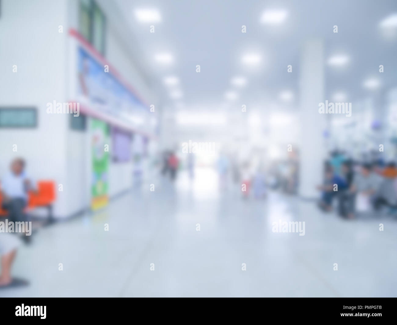 blurred of out department in hospital, opd in helth center wit people inside - Stock Image