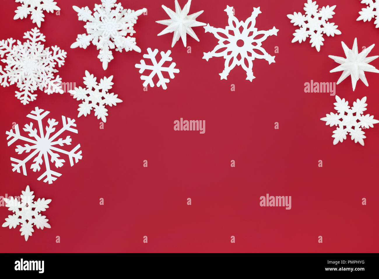 White Snowflake Bauble Decorations Forming A Christmas Background Border On Red Traditional Christmas Greeting Card For The Festive Holiday Season Stock Photo Alamy