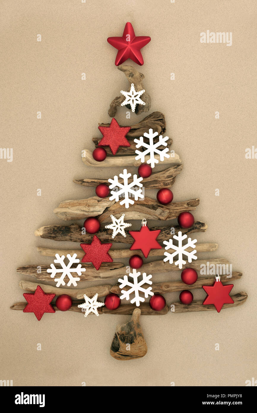 Driftwood Abstract Christmas Tree With Red Star And Ball Baubles And White Snowflake Decorations On Mottled Cream Background Stock Photo Alamy