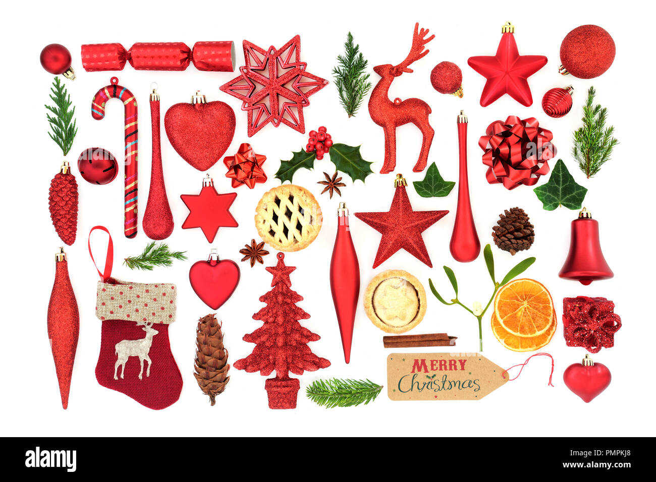 Christmas symbols with tree bauble decorations, winter flora and food items on white background. Festive Christmas card for the holiday season. - Stock Image