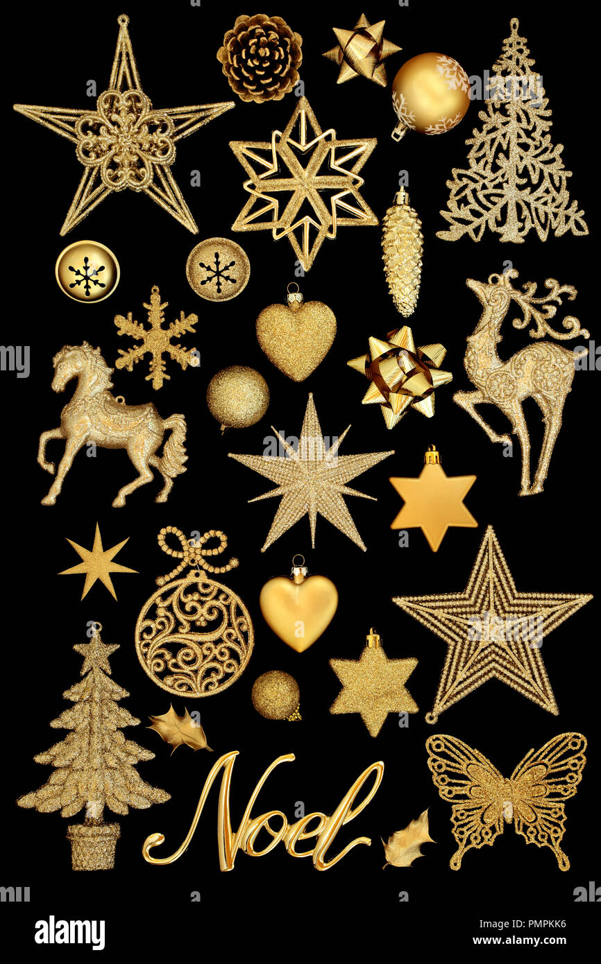 Christmas gold noel with tree bauble decorations isolated on black ...