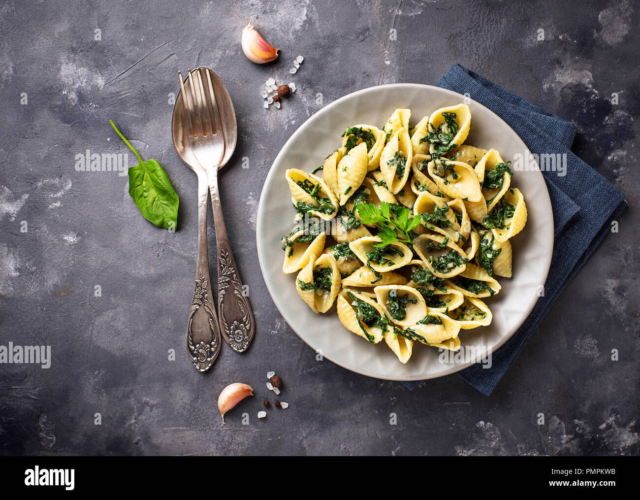 Conchiglioni pasta with spinach in creamy sauce  - Stock Image