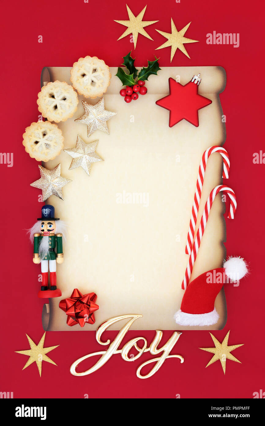 Blank letter to Father Christmas or party invitation with joy sign, mince pies, holly, decorations, candy canes and nutcracker soldier. - Stock Image