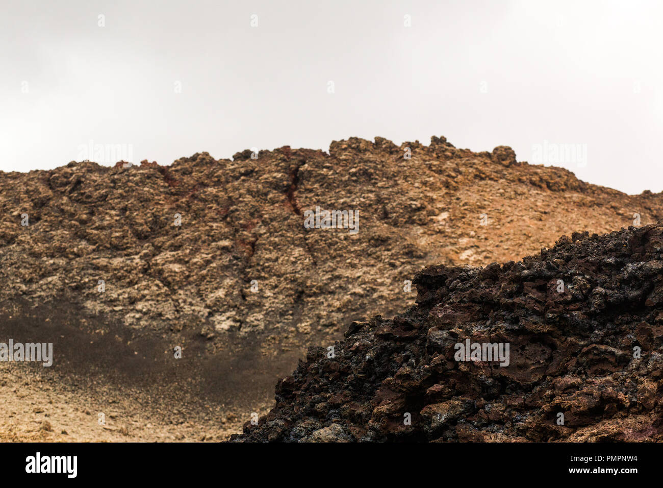 Layers of rocky lava flow from a volcanic eruption in lava fields on Lanzarote - Stock Image