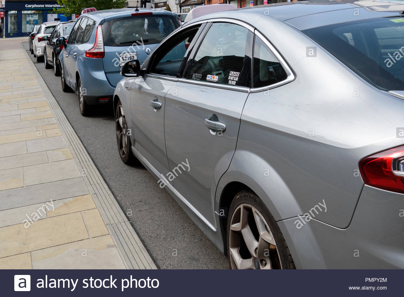 Close up of a row of parked mini cab taxis, Salisbury, Wiltshire, England, UK Stock Photo