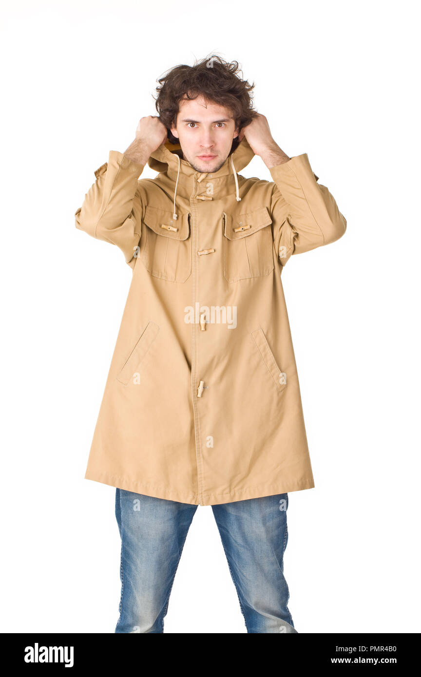 Daily man wearing in raincoat pointing his hood - Stock Image