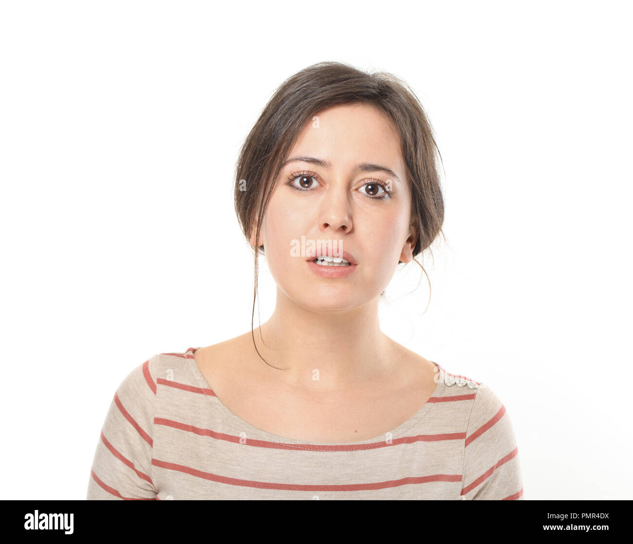 Young woman opening mouth to say something - Stock Image