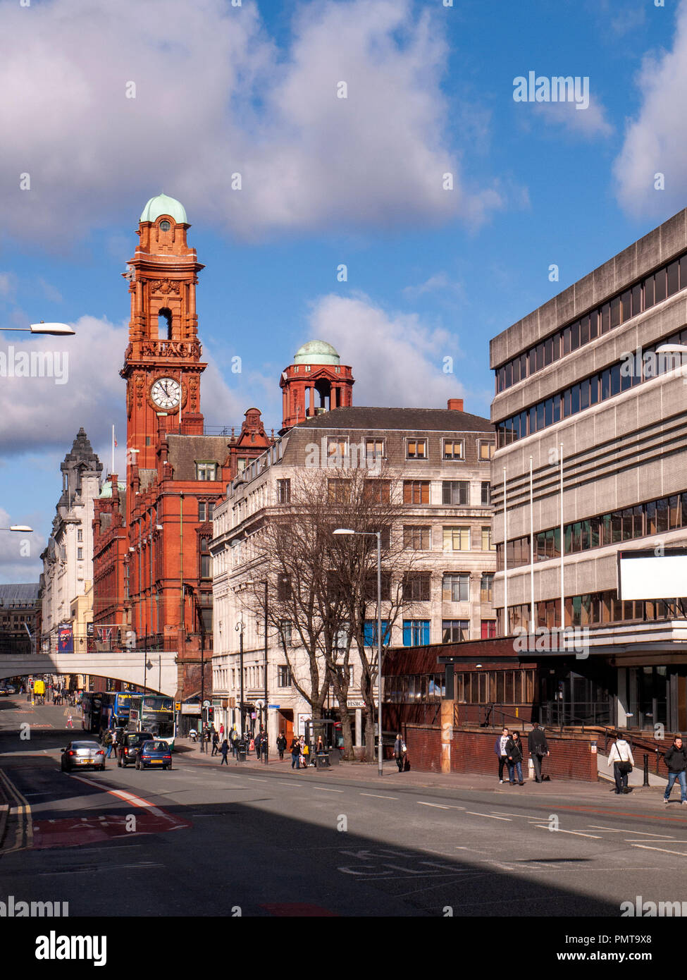 Oxford Road view with the clock tower of Palace hotel in Manchester UK - Stock Image