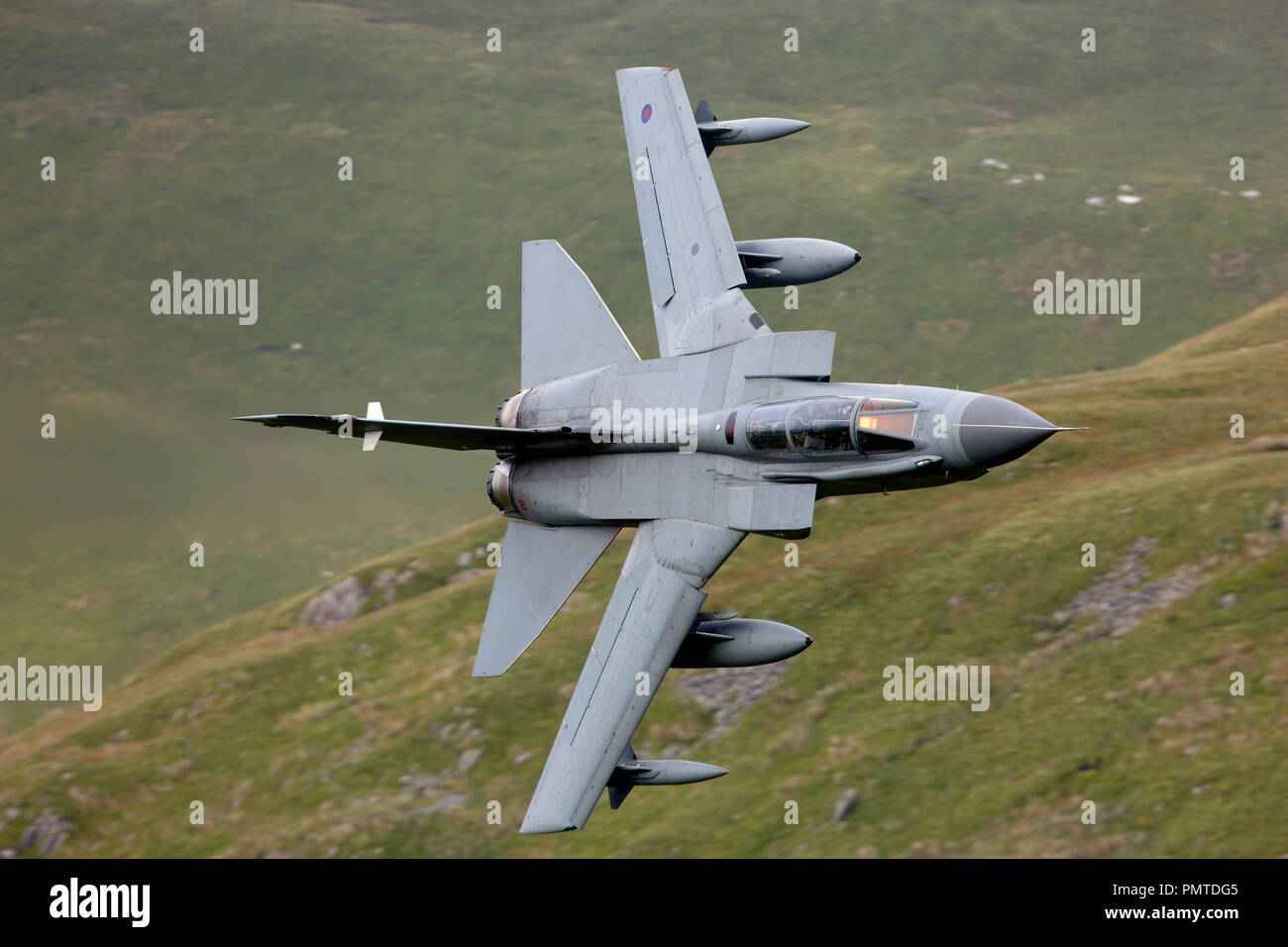 Royal Air Force Panavia Tornado GR4 flying low level in the Mach Loop military low level training area LFA7 Snowdonia, Wales Stock Photo