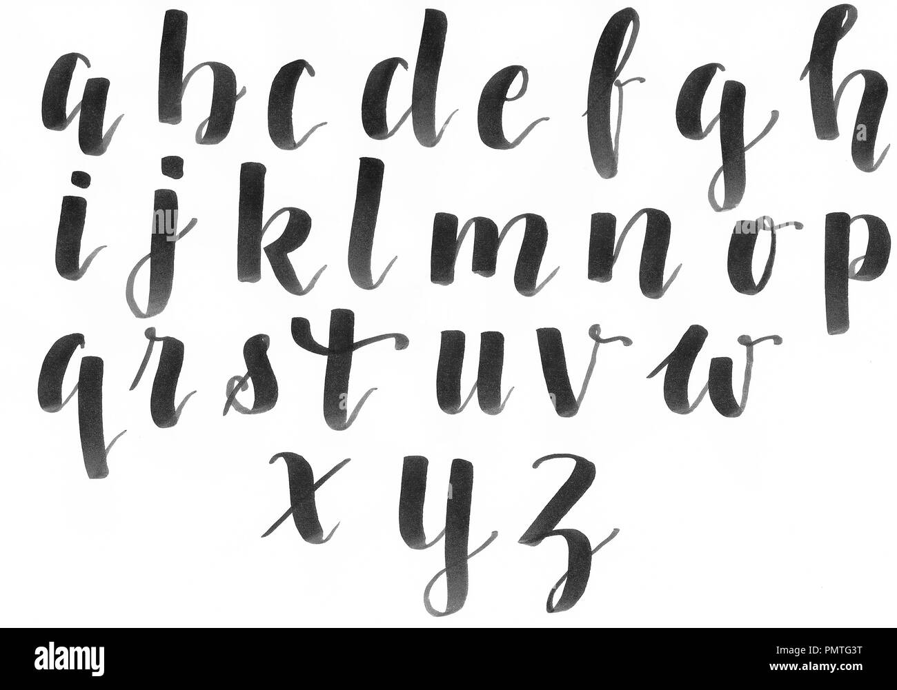 Hand lettering, modern calligraphy alphabet in black on a white