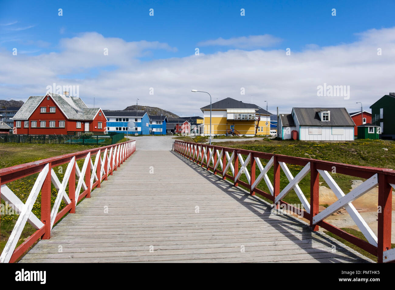 Footbridge and traditional wooden buildings in small town of Paamiut (Frederikshåb), Sermersooq, Greenland Stock Photo