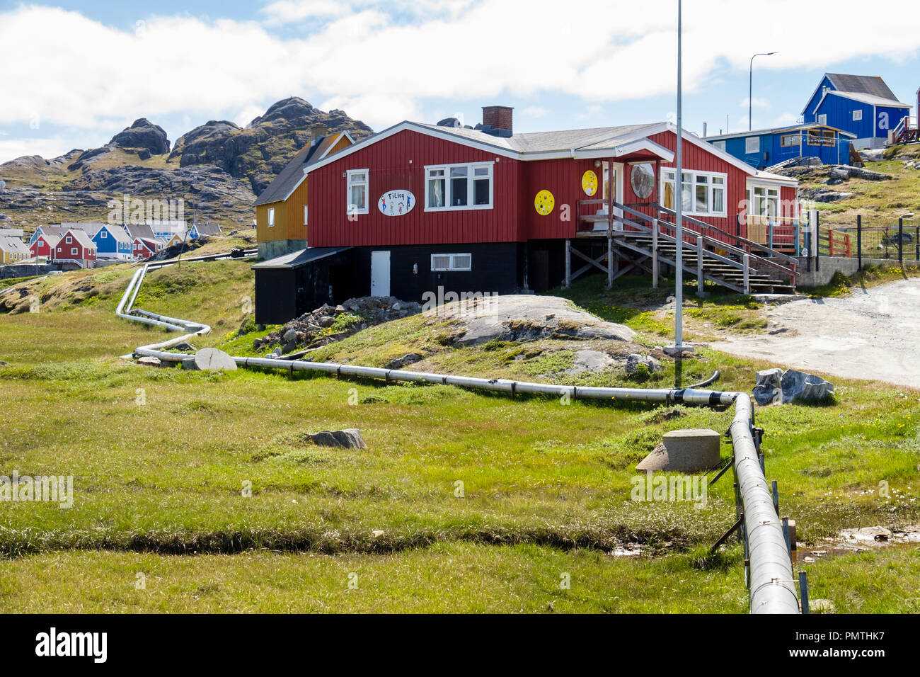Overground pipes for water and waste seen exposed in summer. Paamiut (Frederikshåb), Sermersooq, southwestern Greenland. Stock Photo