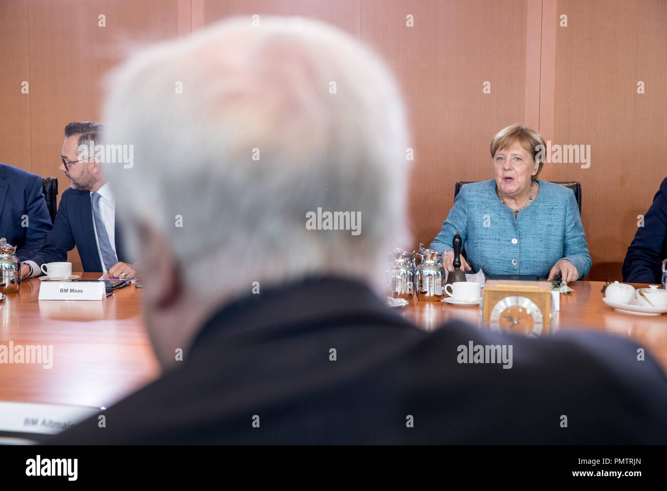 19 September 2018, Berlin: Federal Chancellor Angela Merkel (CDU) sits opposite Horst Seehofer (CSU), Federal Minister of the Interior, Home and Building, at the Chancellor's Office at the beginning of the meeting of the Federal Cabinet. Photo: Michael Kappeler/dpa - Stock Image