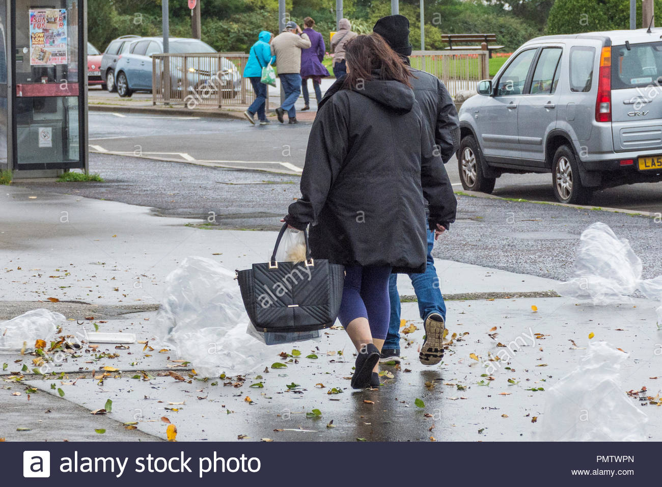 Morecambe, Lancashire, UK, Wednesday 19th September 2018, winds gusting to 50mph blow rubbish around on the seafront, presenting hazards to pedestrians and vehicles. Storm Ali, the first named storm of this season, is causing some disruption to travel and electricity supplies in Northern Ireland, North West England and Scotland. Credit: Keith Douglas News/Alamy Live News - Stock Image