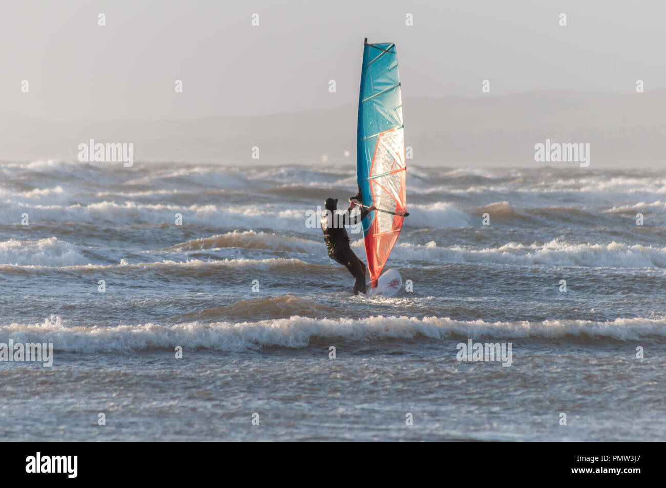 Barassie, Scotland, UK. 19th September, 2018. UK Weather: A windsurfer braves Storm Ali, the first named storm of the winter season. The Met Office have issued an amber weather warning for this area with strong winds and heavy rainfall. Credit: Skully/Alamy Live News - Stock Image