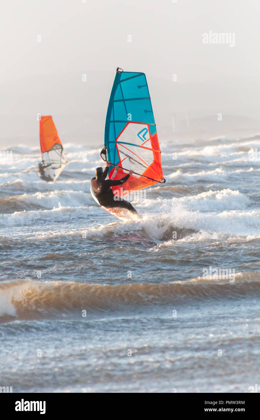 Barassie, Scotland, UK. 19th September, 2018. UK Weather: Windsurfers brave Storm Ali, the first named storm of the winter season. The Met Office have issued an amber weather warning for this area with strong winds and heavy rainfall. Credit: Skully/Alamy Live News - Stock Image