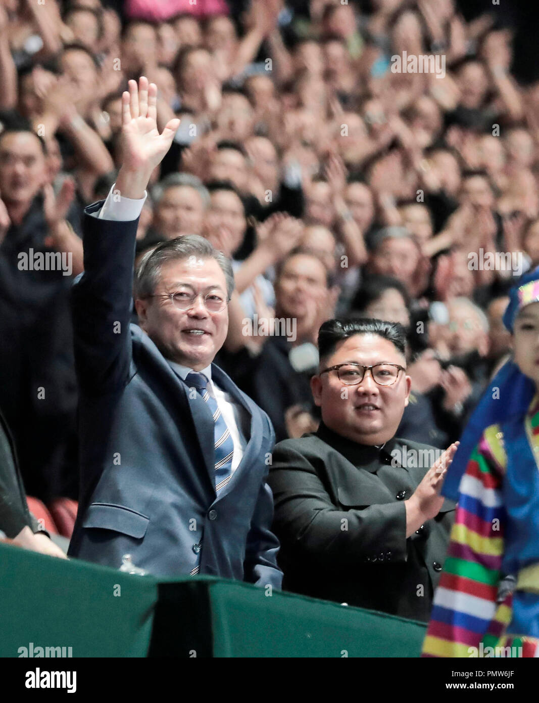 https://c8.alamy.com/comp/PMW6JF/inter-korean-summit-sep-19-2018-north-korean-leader-kim-jong-un-and-south-korean-president-moon-jae-in-along-with-their-wives-wave-to-north-koreans-cheering-before-watching-the-large-scale-gymnastic-and-artistic-show-titled-the-glorious-country-at-the-may-day-stadium-in-pyongyang-north-korea-editorial-use-only-credit-pyeongyang-press-corpspoolafloalamy-live-news-PMW6JF.jpg
