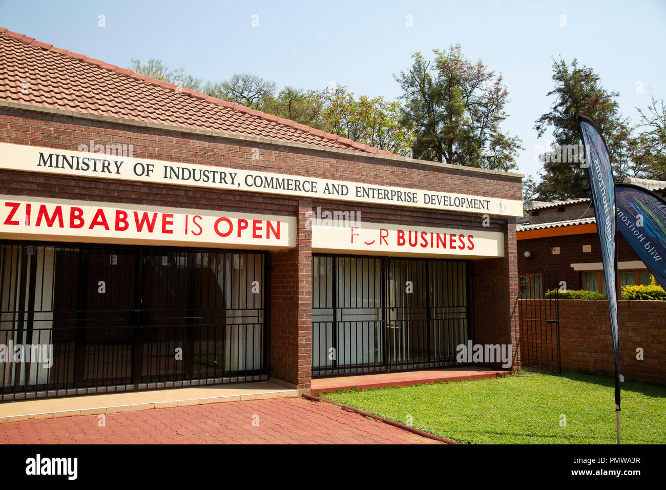 Building at the Zimbabwe International Exhibition Centre (ZIEC) in Bulawayo, Zimbabwe. The facade states that Zimbabwe is open for business. - Stock Image