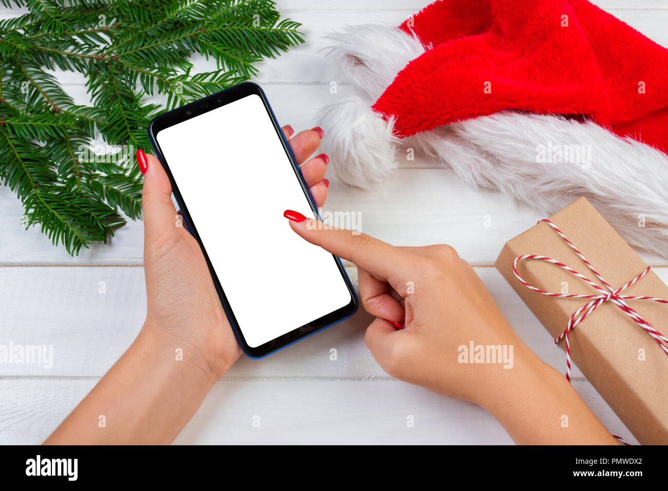 female buyer makes order at screen of smartphone with copy space winter holidays sales christmas online shopping - Christmas Eve Sales
