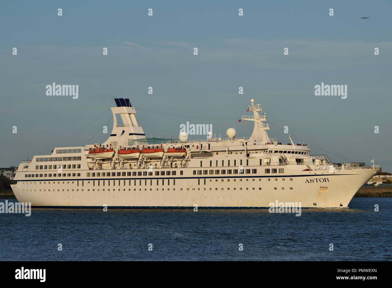 Cruise Ship Astor heads up the River Thames to London in the late afternoon sunshine - Stock Image