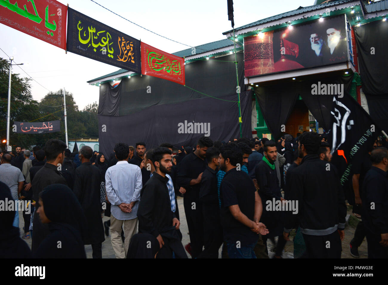 Kashmir Shiite Muslims seen during a religious procession on the seventh day of Ashura. Ashura marks the martyrdom anniversary of the Prophet Muhammed's grandson the revered Imam Hussein who was killed in Karbala, Iraq in 680 AD in southern Iraq in the seventh century. - Stock Image