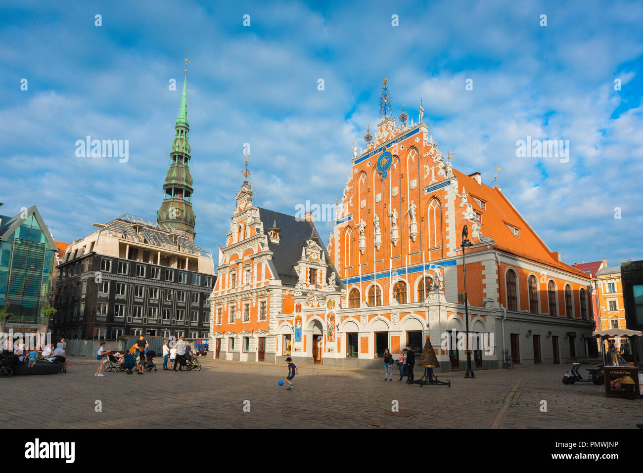 Riga Ratslaukums, view of Ratslaukums Square with the House Of The Blackheads illuminated at sunset, Old Riga, Latvia. - Stock Image
