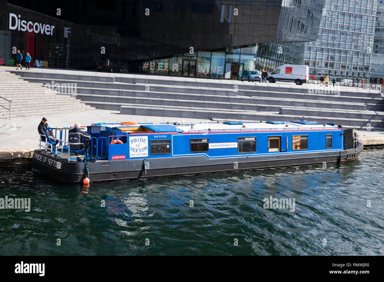 Liverpool Albert Dock area barge Pride of Sefton 2 moored Discover modern contemporary purpose built galleries exhibitions events cafes shops Brasco - Stock Image