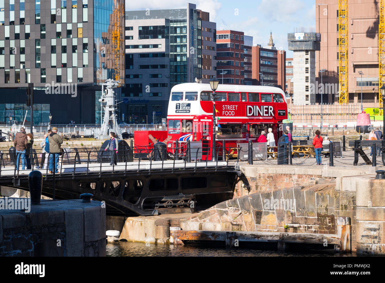 Liverpool Canning Dock double decker London Transport bus Street Food Diner restaurant bar takeaway takeout wooden tables benches red phone book - Stock Image
